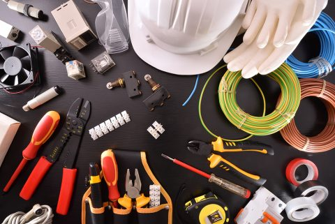 Black table full of electrician supplies