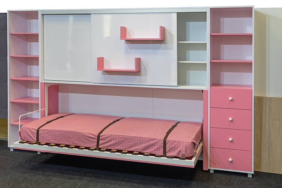 Pink Murphy bed folded down in a children's room
